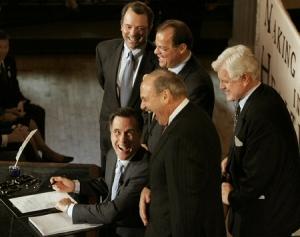 Romney-Signs-Romneycare-200604-JodiHilton-450